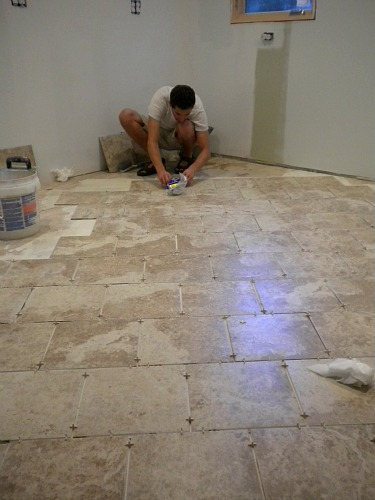 Laying tile in the kitchen