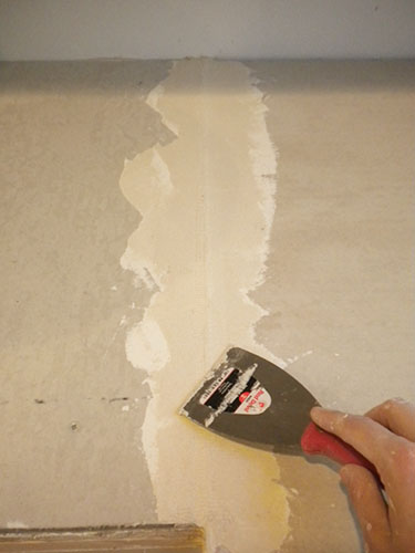 use mesh tape to fill holes before coating counters with Ardex