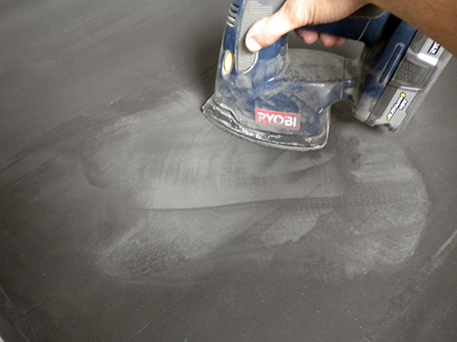 Use a sander to smooth the Ardex over the counter top