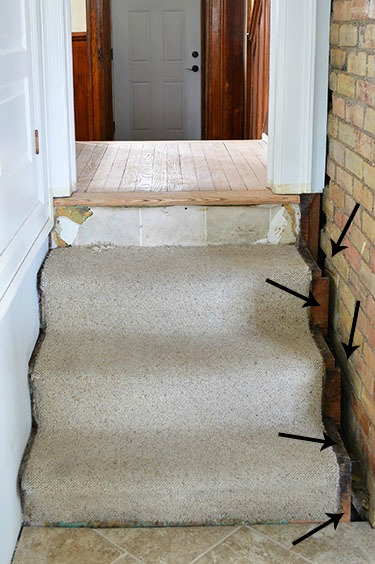 the dangers of pulling carpet off old floors.