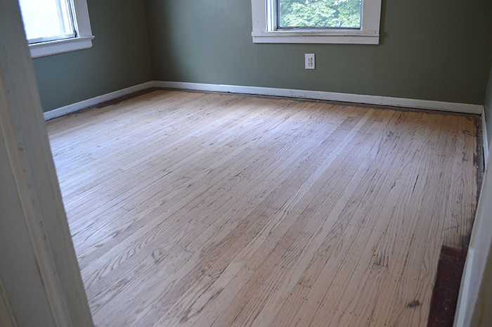 sanding the hardwood floors